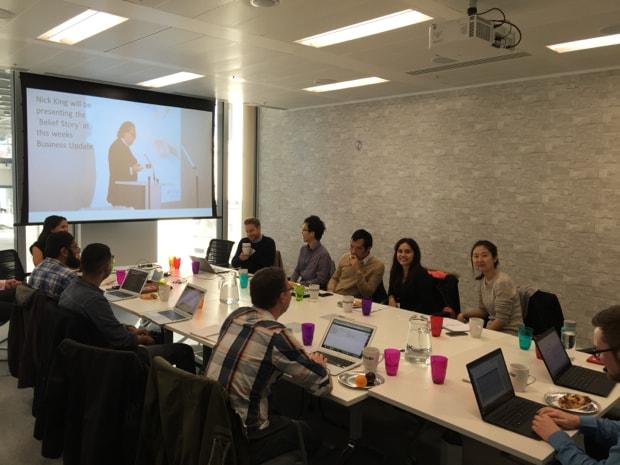Photo of delegates around table