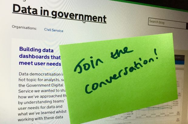 Laptop screen with a post-it note saying 'Join the conversation!'